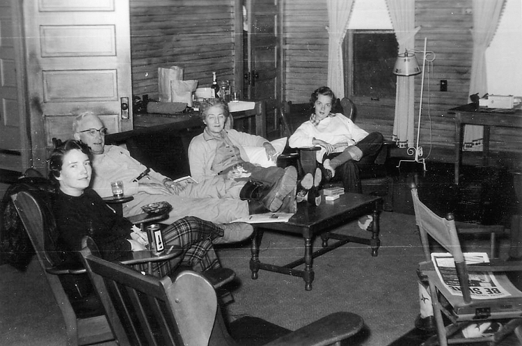 (above) The living area in 1952 was quite the social hangout. From this photo, I can tell that the walls were composed of exposed unpainted shiplap boards or beadboard. And since the family seems to be gathered on an area rug, I'm assuming the floors were wooden with no wall-to-wall carpeting. AND (drumroll) I spy traditional spring roller shades on the windows!