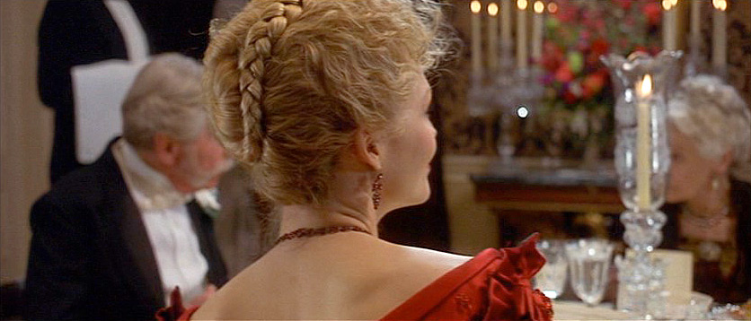 "(from the novel) ""The Countess Olenska was the only young woman at the dinner; yet, as Archer scanned the smooth plump elderly faces between their diamond necklaces and towering ostrich feathers, they struck him as curiously immature compared with hers. It frightened him to think what must have gone to the making of her eyes."""