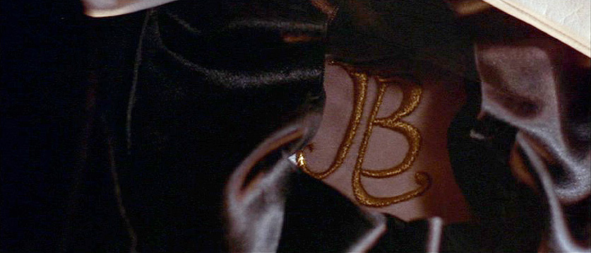 (above) A gorgeous puff-embroidered monogram inside the folded opera hat.