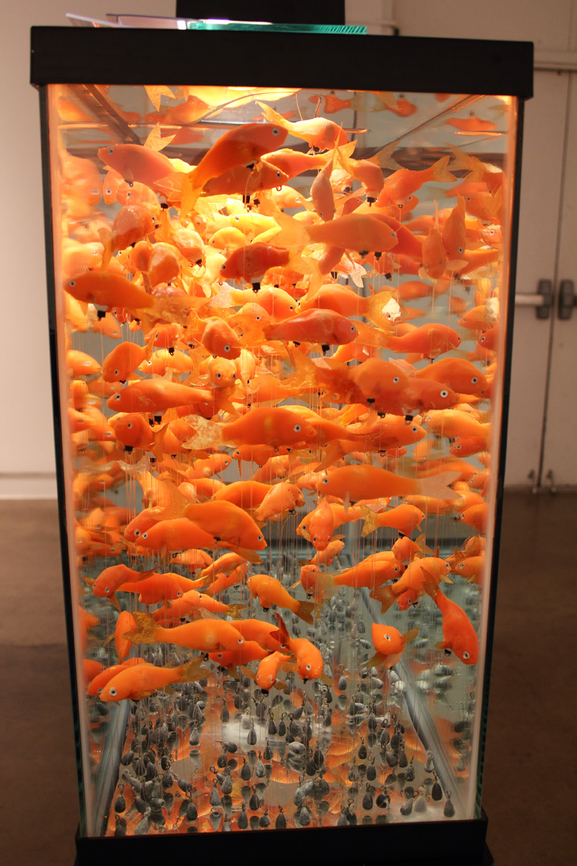 (above) Helen Altman, 'Goldfish,' 2009. Cast plastic, epoxy, lead weights, monofilament line, 45 gallon aquarium and stand, and miscellaneous elements. Side view detail. 57 x 37 x 13 inches
