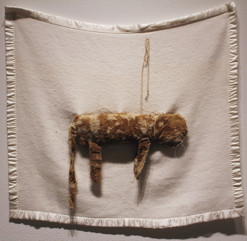 (above) Helen Altman, 'Dog's Kitty,' 2005. Found object on blanket with string, 30 x 31 x 2.5 inches