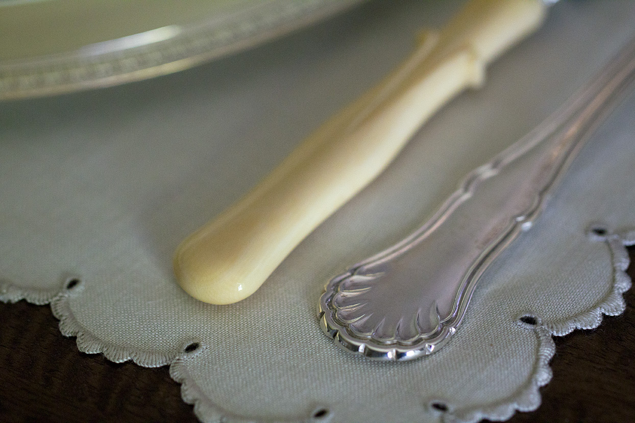 (above) My knives with their organic ivory handles complement my sterling flatware, but do not match. In France, sterling silver was typically given as a wedding gift without the inclusion of knives. The tradition is that knives are considered (as a gift) to be indicative of the breaking or ending of a relationship. You might send a knife to a neighbor you really hate and wish to never speak to again, for instance, and the message will be well taken. Consequently, when knives were purchased later, they never matched the forks and spoons. The owner of the shop where I purchased the knives and flatware always provides generous descriptions and interesting historical tidbits with all her items. If you're curious visit her online shop, Antiques & Uncommon Treasure on Ruby Lane.