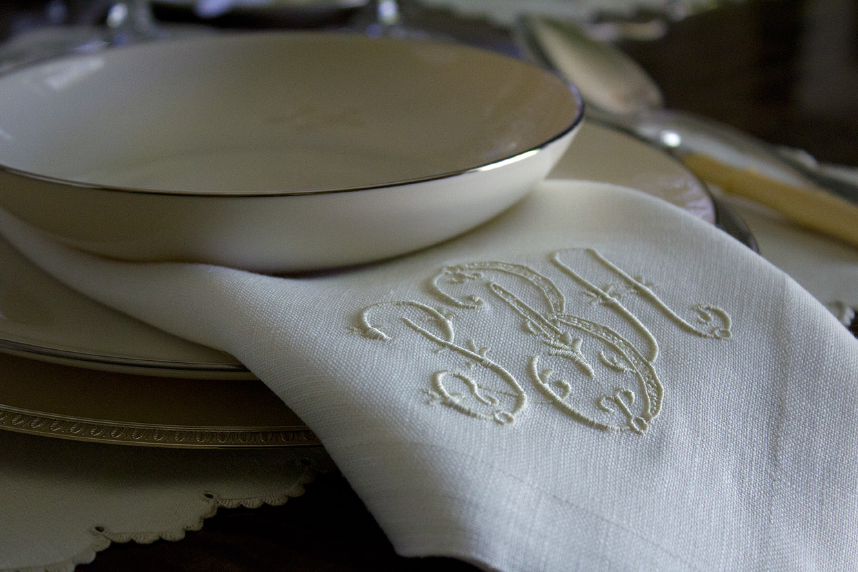 (above) I splurged on a set of monogrammed napkins from Leontine Linens. The linen fabric is ivory, and the monogram thread color is Ice Ballet #9028. The monogram itself is the Addison style. The porcelain was my parents' wedding china, Lenox Olympia-Platinum from 1954. It's not valuable, but the color and shape is superior to the platinum banded porcelain being produced now. I love how the centers of the plates and bowls are smooth and do not have that typical inner circular depression.