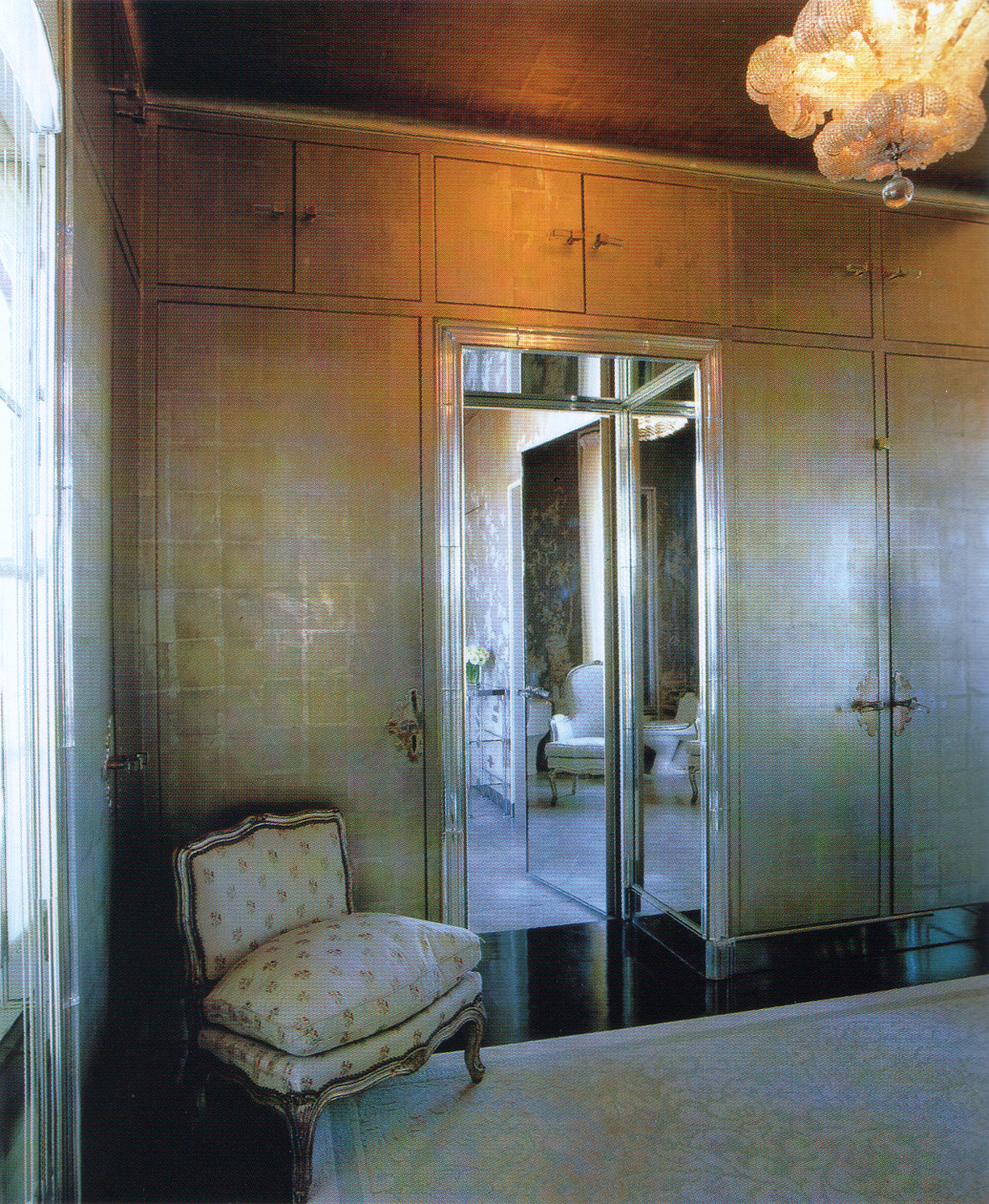 (above) The other end of the Zellerbach dressing room. The mirrored door and doorway lead to the bathroom. The pièce de résistance is the custom Venetian-glass chandelier in the form of a large flower head. Details, such as the closet doors' hardware, fascinate me. I wonder if the escutcheon plates were custom ordered, but the book does not give us the answer.