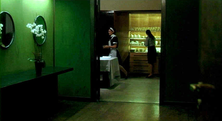 (above) This film still looks through the gun room (fuciliera) into the butler's pantry.