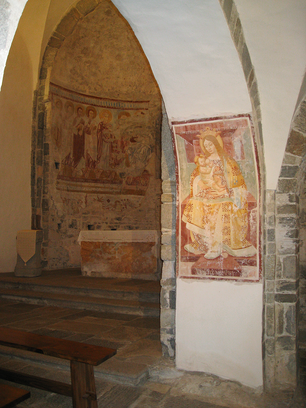 "Above, you can see on the pillar an interesting sixteenth century fresco of the ""Virgin of the Milk,"" Mary breast feeding the Christ Child. This image was very common throughout the foothills of the Alps and recalls the cult of ""Mother Earth,"" but, as here, was often censored by painting over the breast."