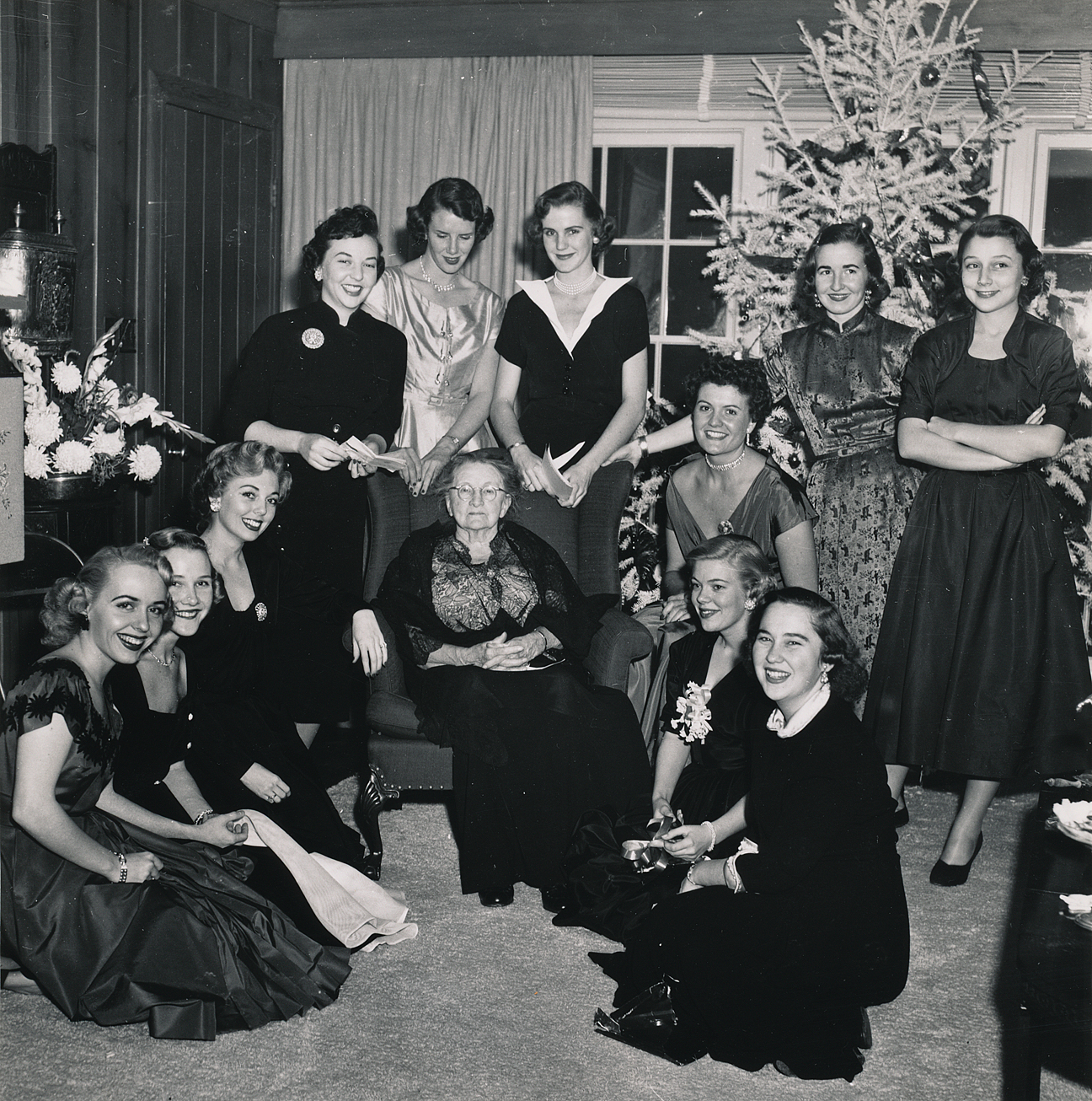 (above) Coffee and desert with the oldest surviving Dallas debutante, whose name I don't know. At left kneeling: Betty Butler, Ann McBee, Mary Jo McCorkle; standing left to right: Phyllis Anne Carter, Carolyn Craugh, Joy Brown, Marilyn Ray, Mary Margaret Lackey; at right kneeling from back to front: Sarah Sharp, Ruth Ann Rogers, Margaret Kervin.