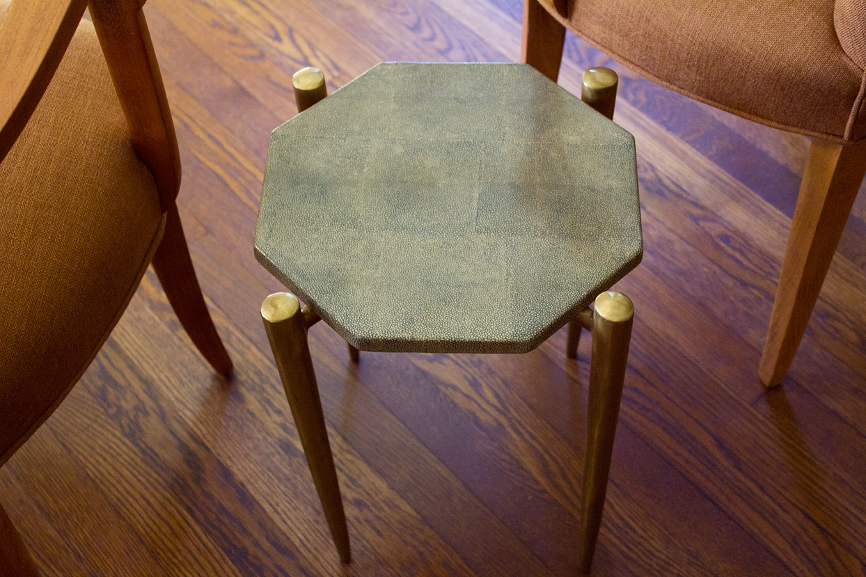 (above) A tiny side table that's just big enough for a couple of cocktails.