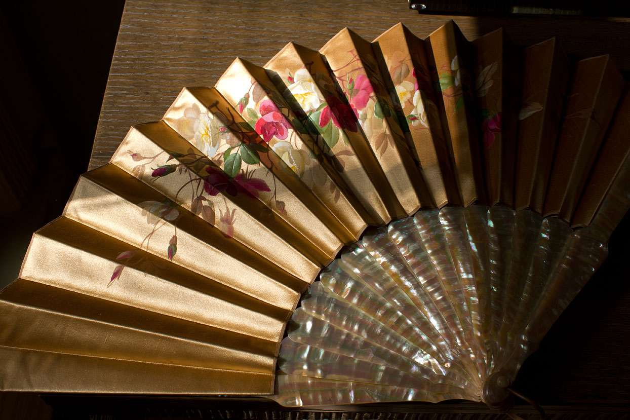 (above) This circa 1900 fan is made of hand painted silk with natural mother of pearl guards and sticks.