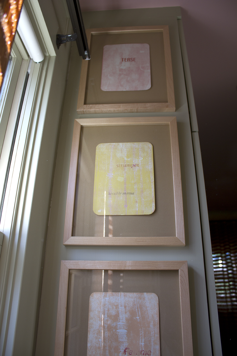 (above) The printed words from top to bottom are tease, strumpet, hoochie mama, femme fatale. The second display of four prints uses some of the same words with the addition of hussy, minx, loose, coquette, whore, and harlot.
