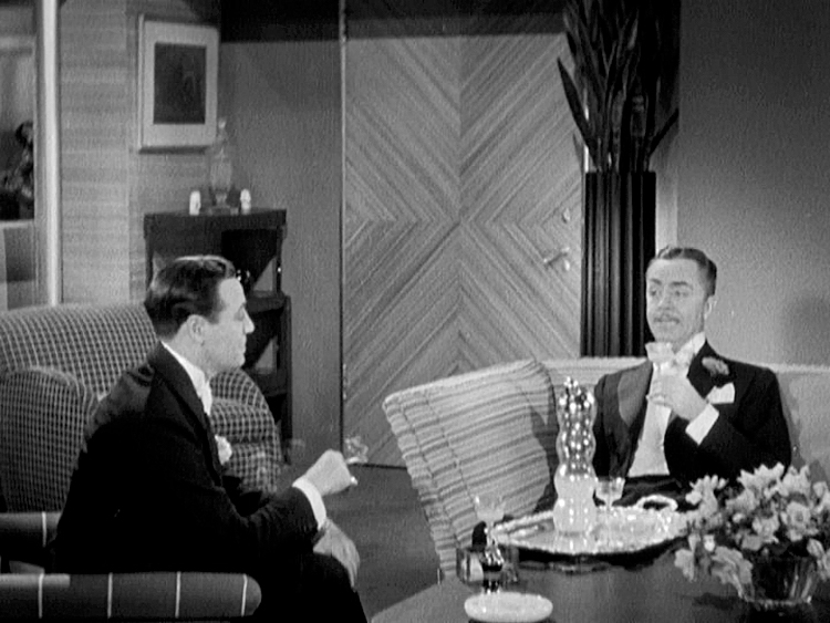 (above) Behind the cocktail-sipping William Powell is the front entrance to the apartment.