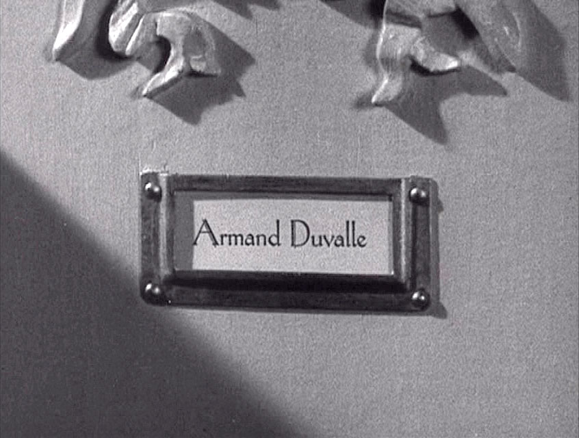 (above) Here's an up-close detail view of the apartment door. I'm guessing that these name cards are engraved.