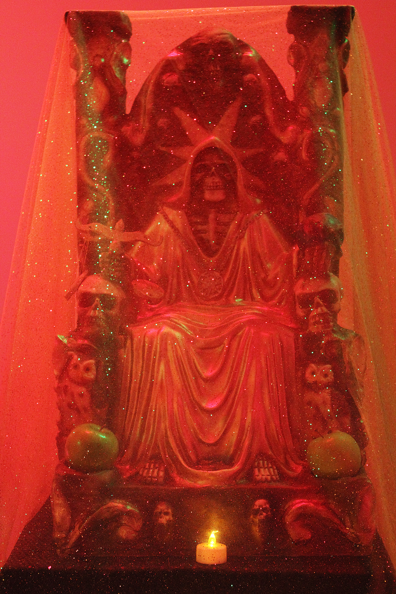 (above) The two photos are details of the first gallery's alter scene. The top one is a depiction of Saint Death.