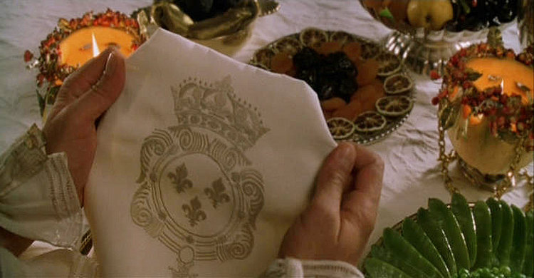 (above) Every detail is noticed by Louis. Here is a linen napkin embroidered with the royal arms of France. From my research this regalia is not accurate and would be the arms used prior to Henry IV. It should show two shields — one for France and one for Navarre.