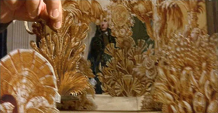 (above) Vatel (Gérard Depardieu) utilizes scaled models to illustrate his plans for each of the three banquets.